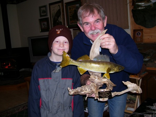 Dave Montgomery and young friend examining a fish mount